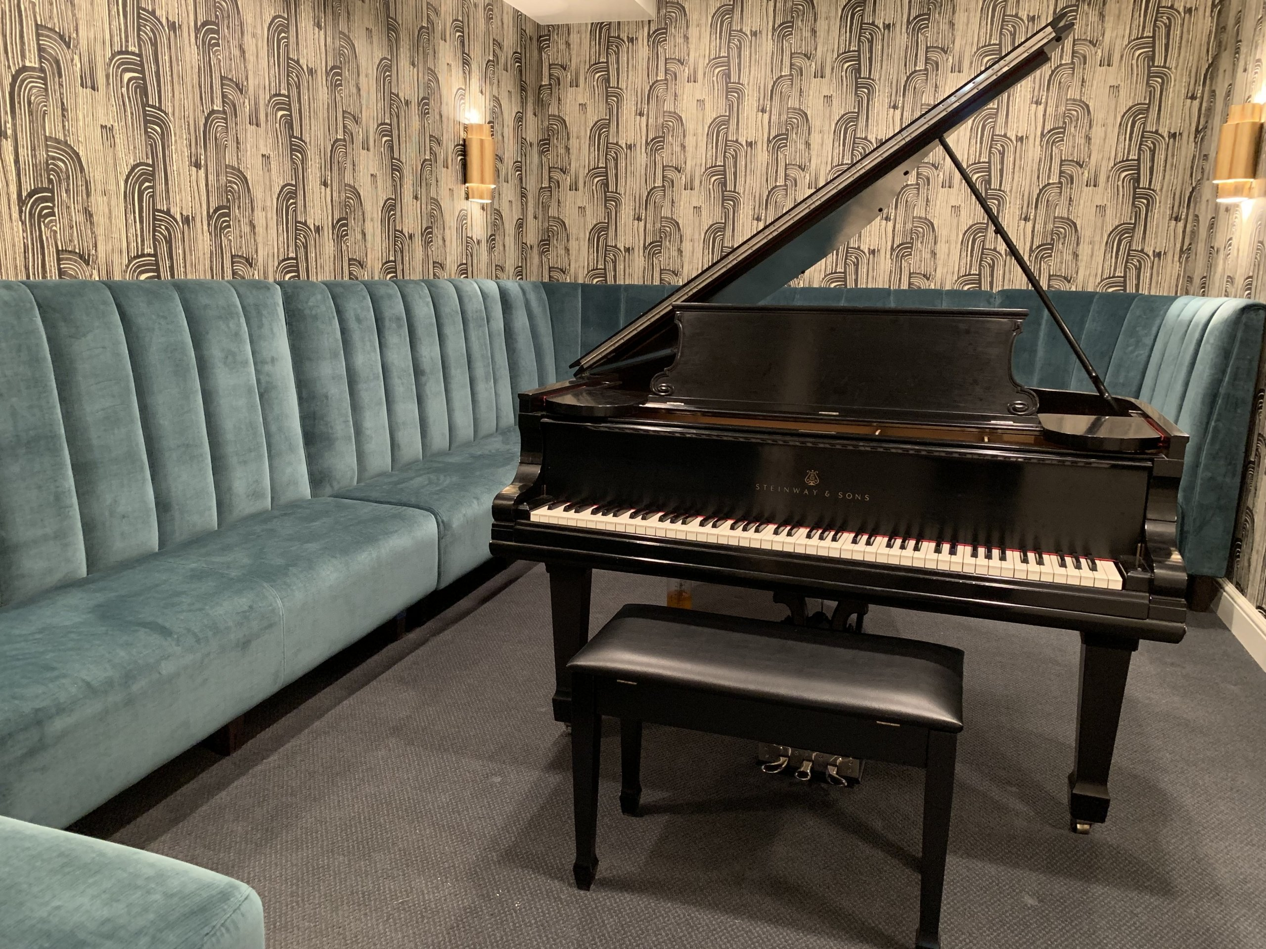 Custom built-in seating for a piano room