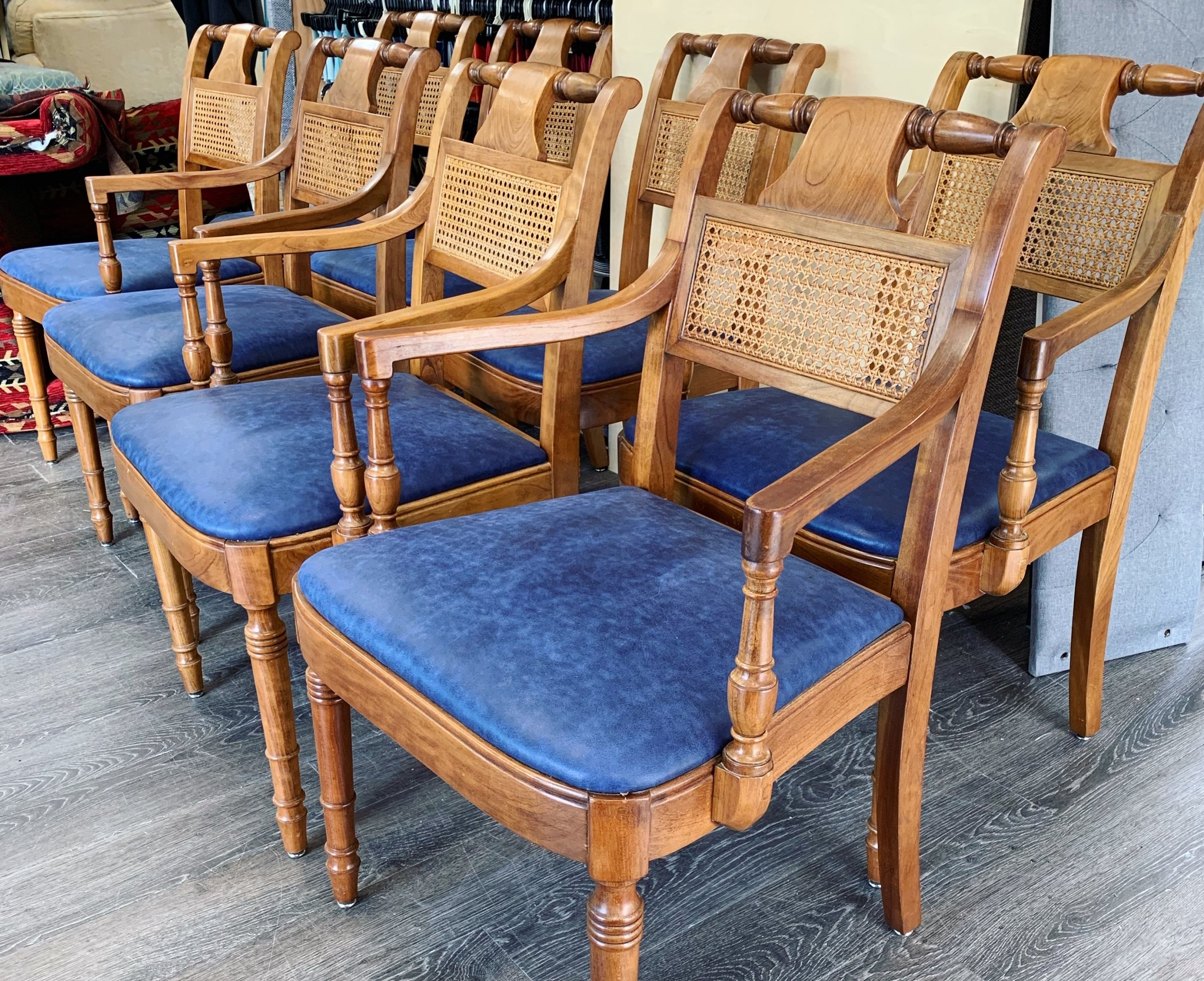 restored antique wooden chairs with leather upholstery