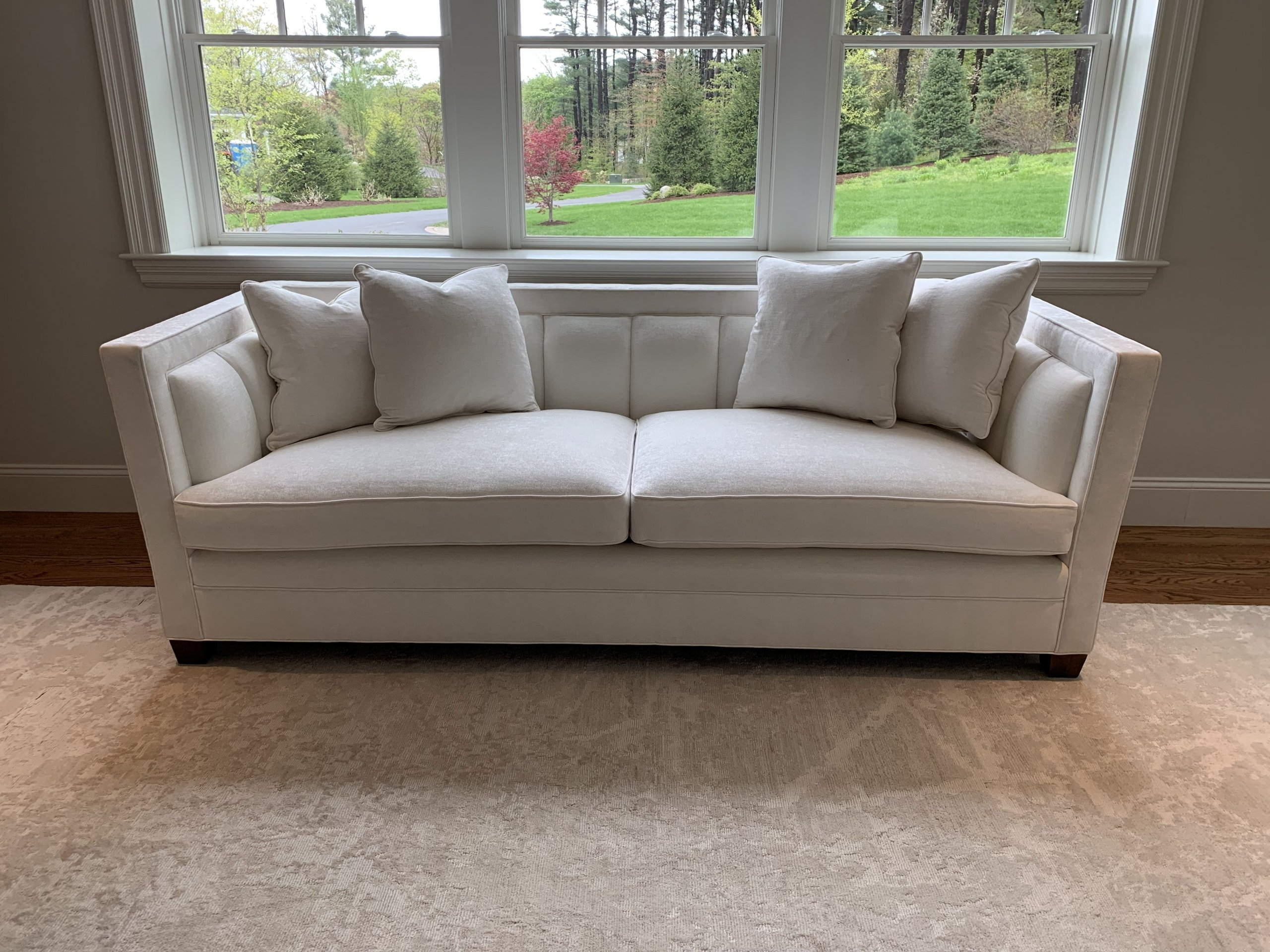 custom upholstered white sofa