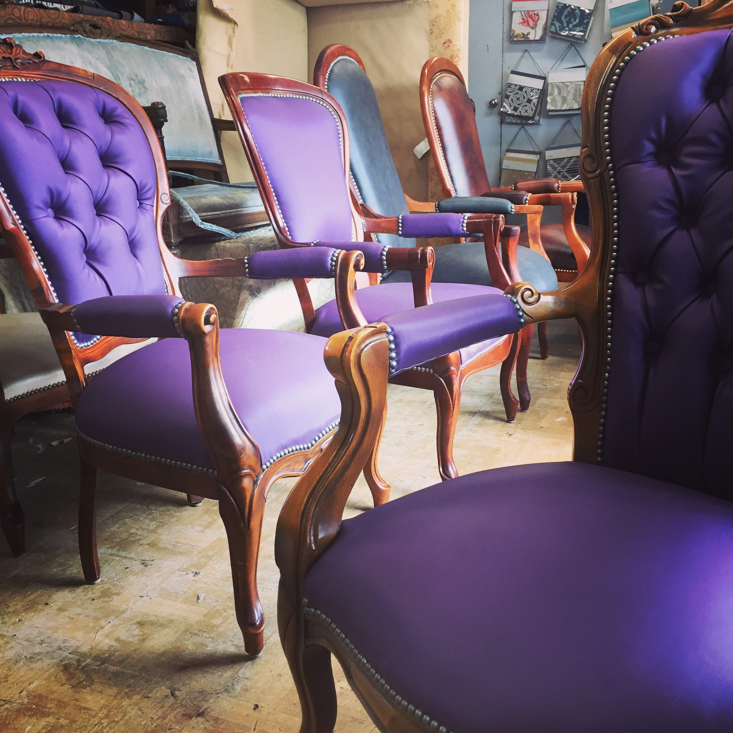 antique restoration custom upholstered purple chairs